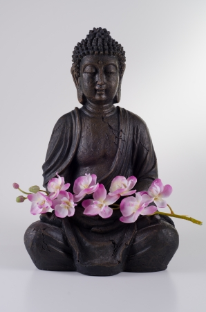 Buddha with Orchid photo