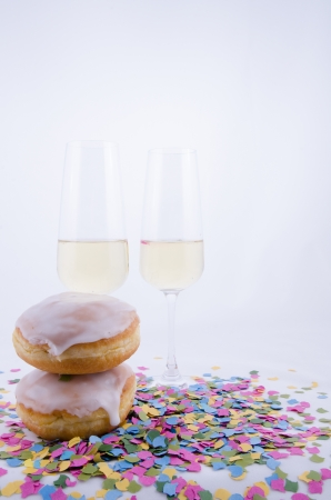Two glasses with champagne - with confetti and cake Stock Photo - 16306793