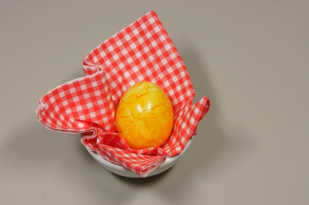 eggcup: egg in eggcup on red white checkered napkin