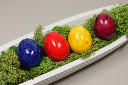 colorful eggs in a white bowl elongated photo