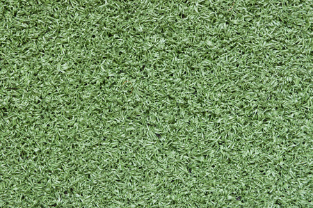 green artificial turf with much structure as a background