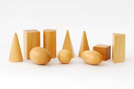 Wooden Geometric Objects against White Background photo