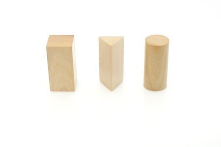 Three Geometry Solids - Cylinder, Rectangular Prism, Triangular Prism photo