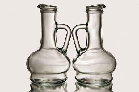 Vinegar and oil bottles in front of white background Imagens