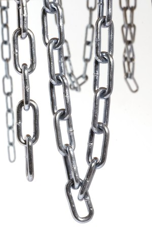 Chains hanging in front of white background photo