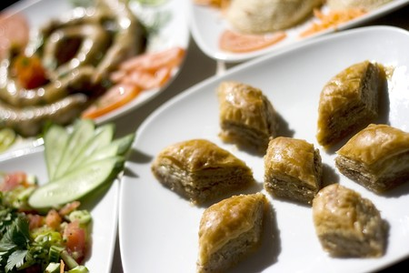 baklawa: Baklava is a traditional Turkish dessert. In this sceene it is surrounded by other traditional foods Stock Photo