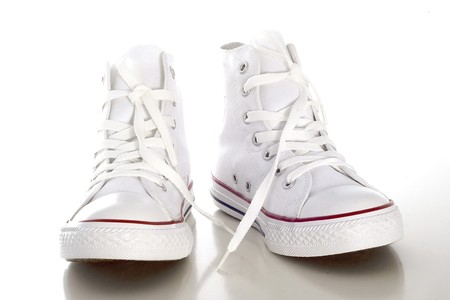 White sport style shoe in front of white background