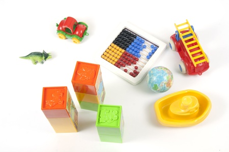 Cubes, abacus, cars, ball, ship ... Different toys on white photo