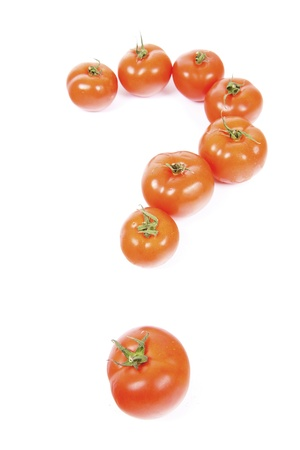 Healthy and delicious tomatos forming a question mark in front of white background