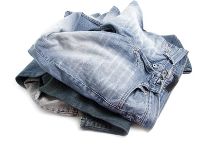 untidy: Different type of untidy jean pants on white