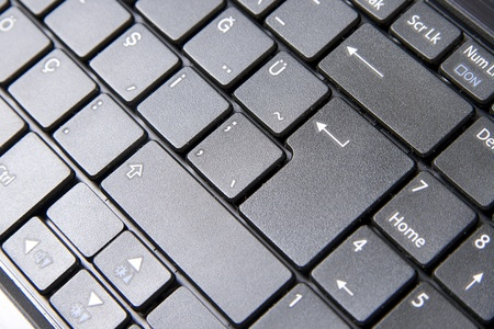 A close up to a laptop keyboard which shows some important keys photo