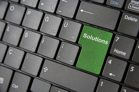 A close up to a laptop keyboard which has a green solution key photo