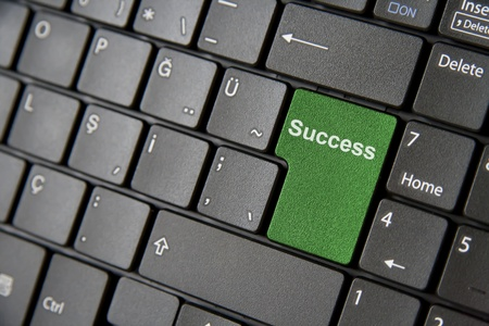A close up to a laptop keyboard which has a green success key photo