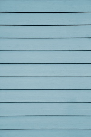 A blue colored design example of a siding which has thin  fuga lines transversely