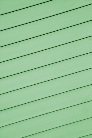 A green colored design example of a siding which has thin crossing fuga lines  Stock Photo