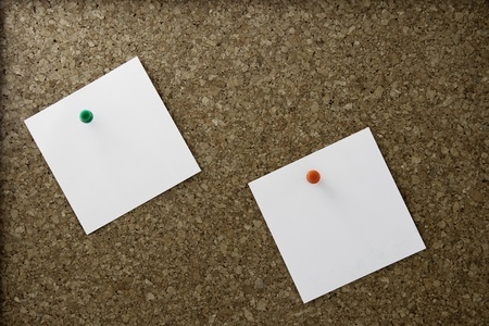 A simple brown cork board with two note papers pinned on Stock Photo - 9961167