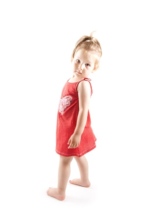 barefooted: A barefooted and red dressed Little girl Stock Photo