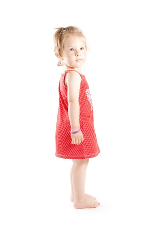 barefooted: A barefooted and red dressed Little girl