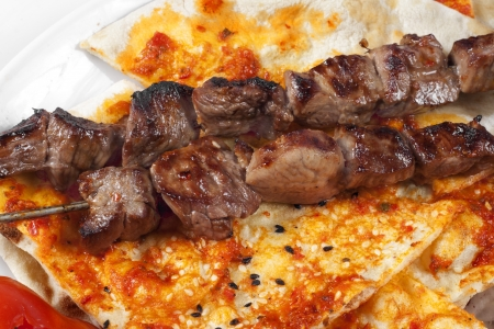 Close up to authentic Turkish shish kebab with pita bread