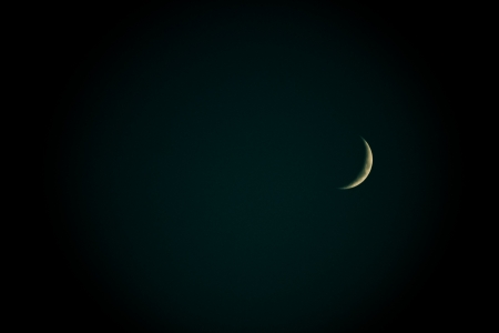 crescent lake: Crescent Moon in the darkness of cloudless sky just after a sunset in Golbasi, Ankara