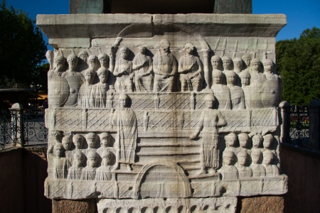 Bas-reliefs on the marble pedestal of Theodosius Obelisk at Sultanahmet Square in the modern city of Istanbul, Turkey photo