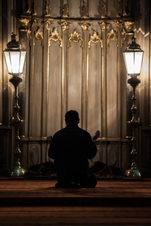 Praying in Eyup Mosque which is an important place for muslims in Istanbul at the evening time