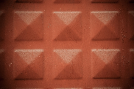 Terra Cotta Colored Iron Door background tiled with square pattern photo
