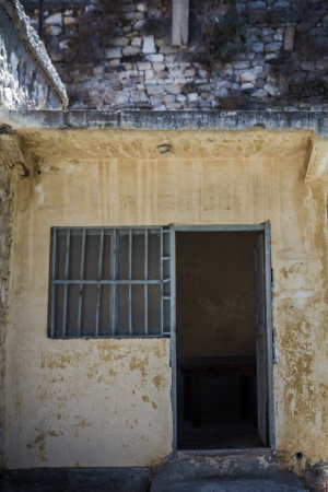 Window of an abandoned historic prison in Sinop Turkey which is open now for visitors photo