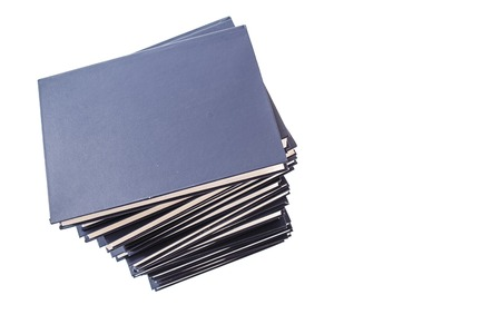 Pile of dark blue hardcover books with copy space on right
