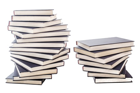 Piles of blue books with copy space on white background  photo