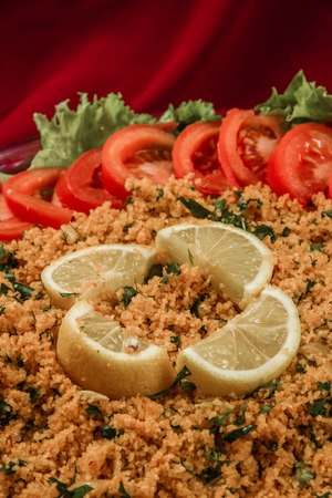 tomato paste: Kisir, traditional turkish appetizer made of steamed cracked wheat and tomato paste Stock Photo