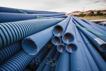 eletrical: Stack of blue pvc pipes for underground eletrical cables of infrastructure