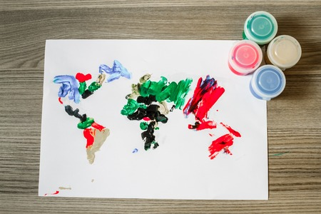 World map painted by a child with finger paint photo