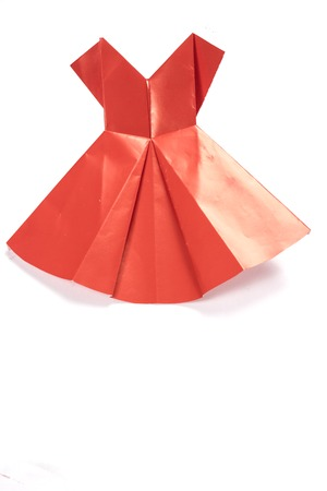 Red origami dress on white background photo