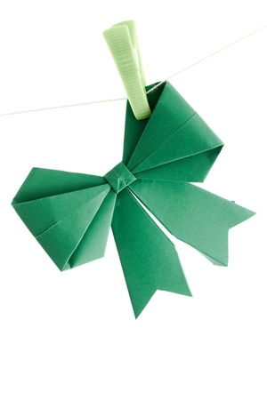 Green origami ribbon on white background photo