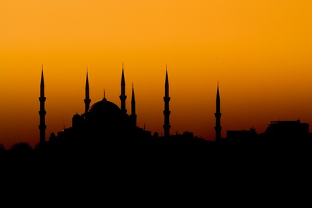 Beautiful silhouette of a mosque at sunset on the Bosphorus photo