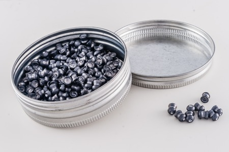 airgun: Box of airgun pellets on plain white background Stock Photo