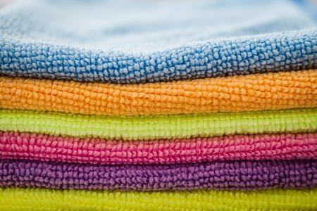 dishtowel: Close view of purple, blue, pink, orange, green,yellow napkins Stock Photo