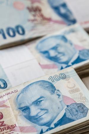 lira: Bunch of Turkish Lira over white wooden background