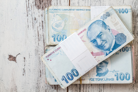 turkish lira: Bunch of Turkish Lira over white wooden background