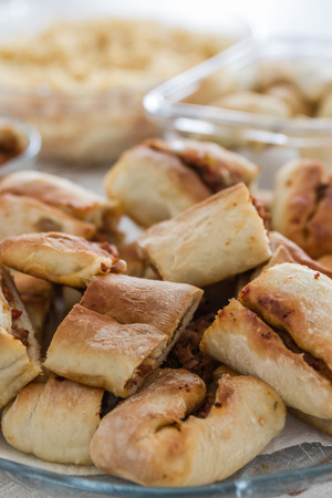 yufka: Homemade traditional Turkish pastries like pide and borek on a table Stock Photo