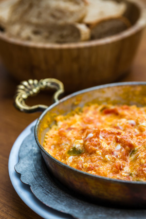 Menemen, Turkish breakfast food with egg, tomatoes and pepper in pan
