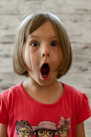 surprised kid: Surprised little girl with funny facial expression Stock Photo