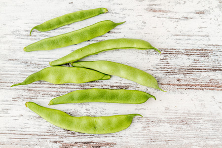 greenbeans: Fresh raw green beans on white wooden background