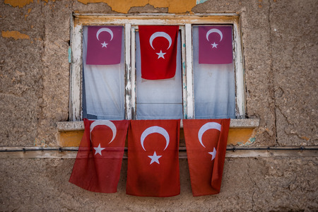 yellow house: Old yellow house with Turkish flags