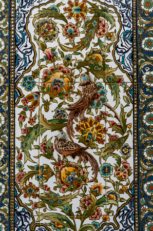 pay wall: BODRUM, TURKEY - AUGUST 29, 2015: Turkish artistic wall tile from local artist Nagihan Ozsarsilmaz Pay on August 29, 2015 in Bodrum. Editorial use only.