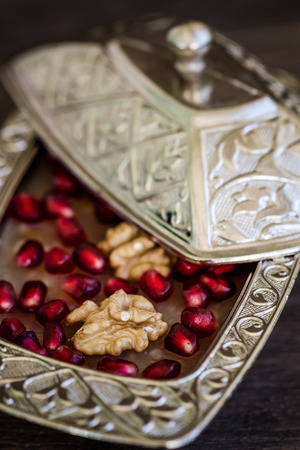 turkish dessert: Turkish dessert Ashure, Noahs pudding, with pomegranate seeds and walnuts Stock Photo
