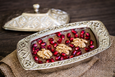 Turkish dessert Ashure, Noahs pudding, with pomegranate seeds and walnuts Imagens