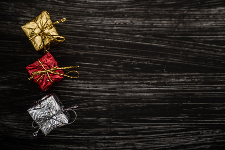 golden: Red, white and golden Christmas toys and decorations on dark background with copy space Stock Photo