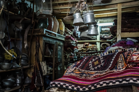 antique shop: Antique carpets and copper pots for sale in an antique shop at Harput, Elazig